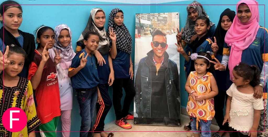 The children of Lyari posing with a photo of Coach Emad at the Sarbazi Health & Boxing Club