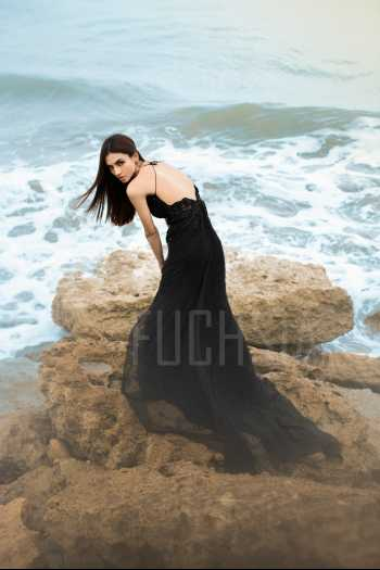 Black flowing dress against the beach, water with black dress, Javeria