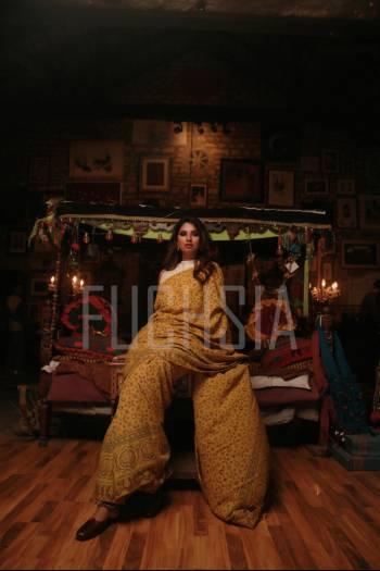 Woman in yellow block printed sari