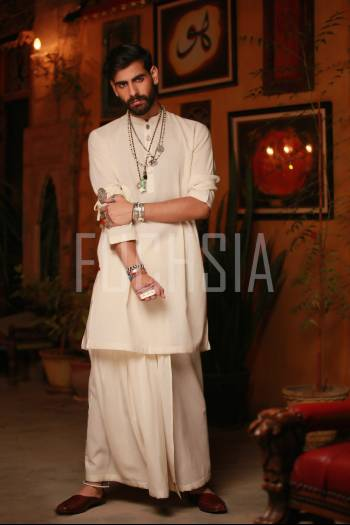 Man in white with ethnic jewelry