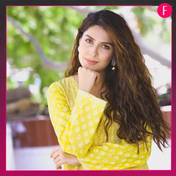 Girl in yellow shirt with long hair, Ayeza Khan