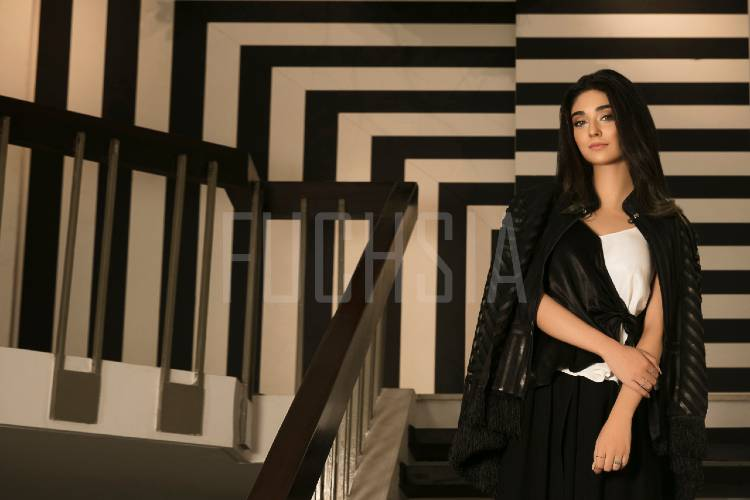Noor Khan in white, brown and beige stripes, white dress