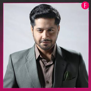 Imran Ashraf, Man in grey suit
