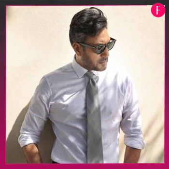 Mani in white shirt and tie, dark glasses, Adnan Siddiqui