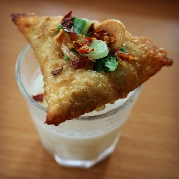 Samosa over coconut curry