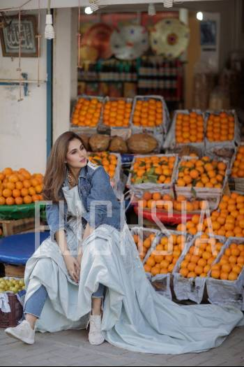 Oranges, girl in denim and white