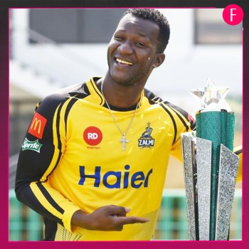 Darren Sammy holding the cup