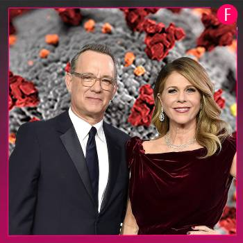 Man and woman wearing blcak, Tom Hanks and wife