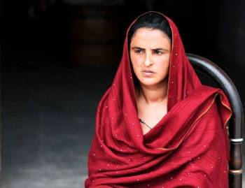 Woman in red shawl