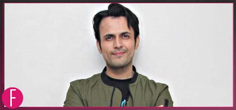 Usman Mukhtar in Brown jacket