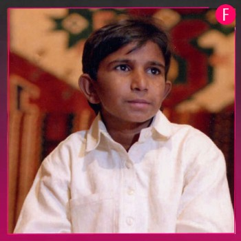 Iqbal Masih, small boy in white Kurta shalwar