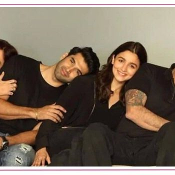 five people on a couch, bollywood stars posing